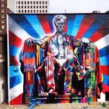 I see this painting at least 4 days a week on my walk back to my dorm after class. It has a very colorful, and fun stylist view.It's honestly one of my favorite things about this small city. But why on the side of this building? Why is the background red white, and blue? Why is it this picture of good ol' Abe? Why Abe?