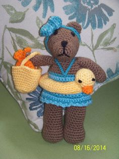 Crochet stuffed girl bear with bathing suit, ducky inner tube and pail with fish
