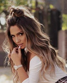 Top knot. Half updo hairstyles perfect for the summer. Keep the hair out of your face but still keep the luscious curls.