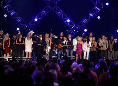 Garth Brooks Photos - ACM Artist of the Decade award winner George Strait performs onstage with Kristian Bush, Jennifer Nettles, Taylor Swift, Eddie Montgomery, Tim McGraw, Faith Hill, Troy Gentry, Kix Brooks, Ronnie Dunn, Lee Ann Womack, Garth Brooks, Blake Shelton, Martina McBride, Miranda Lambert, Dierks Brooks, Jamey Johnson, and Jamie Fox during the 44th annual Academy Of Country Music Awards' Artist of the Decade held at the MGM Grand on April 6, 2009 in Las Vegas, Nevada.  (Photo by…