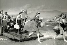 Red Cross workers land on the beach in France, 1944