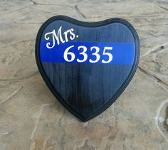 Check out this item in my Etsy shop https://www.etsy.com/listing/261223516/thin-blue-line-heart-plaque-mrs-badge