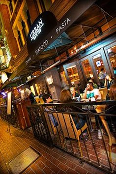 Sidewalk Patio at Urban Bar & Grill where guests can watch all the action in the Gaslamp Quarter