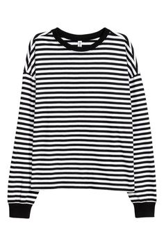 Black/white striped. Long-sleeved top in soft cotton jersey with ribbing at neckline and cuffs.