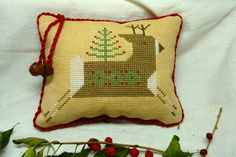 Finished / Completed Primitive Cross Stitch Pillow Ornament - Decked For The Holidays - Stitched From a Design by The Workbasket