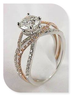 This is my dream ring. Three crossing bands but with a circular, oval, or pear shaped diamond on top. And in all white gold! ❤