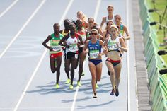 Kim Conley of the United States and Laura Whittle of Great Britain lead the pack during the Women's 5000m Round 1 - Heat 1 on Day 11 of the Rio 2016 Olympic Games at the Olympic Stadium on August 16, 2016 in Rio de Janeiro, Brazil.