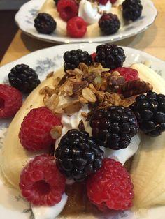 Breakfast Banana Split.  Bananas split with Siggi's Yogurt, fresh summer berries, and Glencairn Granola on top!
