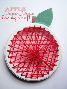 Apple Paper Plate Lacing Craft - what a great way for kids to practice patterns and fine motor skills!