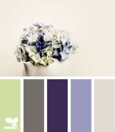 bouquet tones - navy bedding, light blue walls, white curtains, green & gray accents