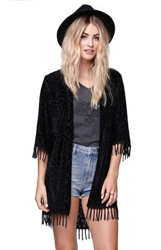 The Velvet Kimono by Kendall & Kylie for PacSun and PacSun.com features a tribal velvet pattern throughout along with fringe trim. We love the relaxed flowy fit and soft fabric. Throw this on over your dresses, or with a simple jeans and t-shirt look!