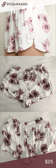 White and Pink Floral Shorts these are flowy shorts from brandy Melville that are a size small to medium and have adjustable strings to loosen or tighten them. Feel free to make an offer! Brandy Melville Shorts
