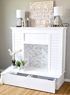DIY Faux Fireplace with Shiplap and Extra Storage is part of Living Room Storage Fireplace - If you don't have a fireplace, build one! This DIY faux fireplace features cute, ontrend shiplap, limewashed faux brick and even extra storage space White Fireplace, Diy Fireplace, Fireplace Inserts, Fireplace Makeovers, Painting Fireplace, White Mantel, Fireplace Remodel, Room Makeovers, Brick Fireplaces