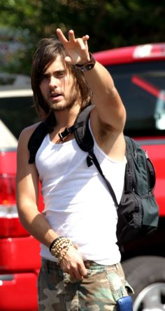 Jared Leto, I just love this photo so much. It makes me cry. The bracelets, the backpack, the hair. He's a sexy hitchhiker who stowed away in my heart.