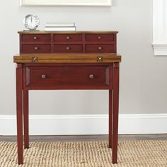 """Safavieh American Home Collection Leyton Cherry and Honey Oak Writing Desk. The cherry and honey oak finish of this writing desk will make a perfect accent for any home. This desk features six top drawers, each measuring 8.5"""" x 8.1"""" x 2.4"""", and one larger bottom drawer measuring 22.8"""" x 16.9"""" x 5.9"""". Crafted of solid pine wood. Perfect for a living room, family room, den, library, or study. Assembly required, this desk measures 29.5 inches wide by 18 inches deep by 38 inches tall."""