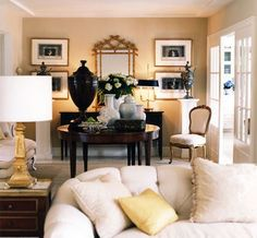 living room.  (Mary Mcdonald). Great idea for incorporating Nana's pictures onto the walls.