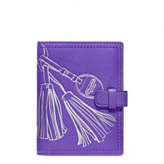 Leather Passport holder from Coach. Travel with style!