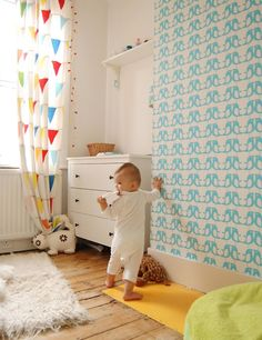 Love this baby room in the London home of Laura Aziz…Ikea all over! Shelves, dresser and Ikea  curtains too. (I almost ordered those.) She not only has a cute nursery, but a cute little shop too!