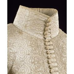 Detail of ca 1635-40 glazed and bleached linen man's doublet, showing passementerie buttons and beautiful linen embroidery. English in origin.