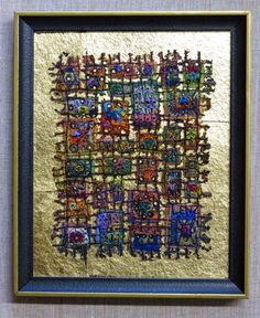 I have liked her work since I first found her on the internet several years ago...Check out her stained glass piece...Art In Stitches