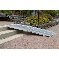 The folding wheelchair ramp set up on stairs