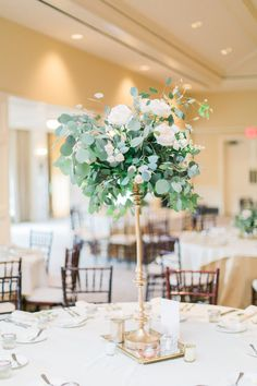 eucalyptus and rose tall wedding centerpiece
