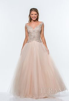 Terani Prom 2015 Collection @ Rubie&Jane in Lufkin, TX. Tulle prom ballgown with decollete neckline and pearl and sequin circular embellishments over the bodice and onto the high hip, the dress is finished with a full tulle skirt. Come see us at Rubie & Jane for Prom 2015!