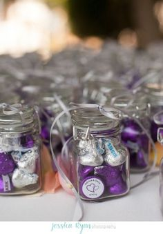 Purple chocolate kisses favors making a vivid statement.  See more Hershey Kiss wedding favors and party ideas at www.one-stop-party-ideas.com