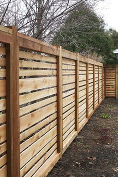 A very nice horizontal timber fence with space between boards and varied board sizes
