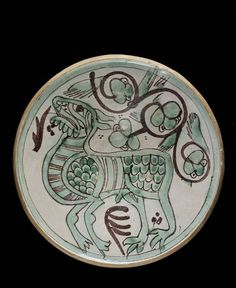 Earthenware dish with tin-glaze and painted in green and brown. Made in Spain (Paterna) in about 1325-1350