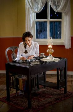 Elizabeth writing in her new place.