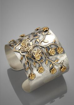 SoHo Styles yellow gold plated flower and butterfly cuff - too cute!