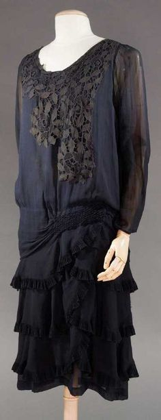 c.1928 navy blue lace bodice over-lay, smocking at hip above overlapping tierred skirt.