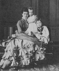 Tsarina Maria Feodorovna of Russia, nee Princess Dagmar of Denmark, with her sons Grand Duke George Alexandrovich (held) and Tsarevich Nicholas Alexandrovich (standing)