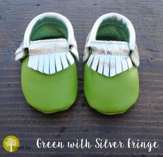 These baby moccasins are made with genuine leather. There are many color options to match every outfit. They look great on your child's foot and they have an elastic material in the cuff to help them stay on your child's foot.