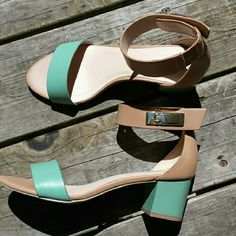 Charles David Sandals These beautiful tan and dark mint sandals are great for the spring and summer. I wore them a couple of times so they are in pretty good condition. There are small scratches on the buckle of the left shoe. Charles David Shoes Sandals