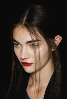 Rochas S/S 2013 -- clean face, bold brows/lips