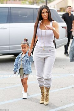 Getting warmer: As things started to heat up in the Southern California city, Kim opted for a basic white tank top and comfortable track pants for their mother-daughter adventure