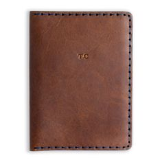 Personalised Hand Stitched Leather Passport Wallet | Man Gun Bear £69    This classic hand stitched passport wallet is made from high quality UK leather and can be personalised with your initials.    https://mangunbear.com/collections/personalised-mens-travel-accessories/products/personalised-hand-stitched-leather-passport-wallet    #passport #travelaccessories #leather #mangunbear