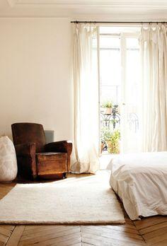 floor, white, leather armchair.
