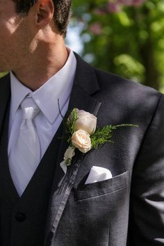Classic boutonniere idea - neutral floral boutonniere with greenery {Tricia McCormack Photography}