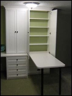 Hide away table- there when you need it, gone when you dont, AND with more storage shelves behind the table, all concealed in a nice neat cabinet!