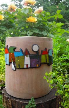 Another style of mosaic planter with houses.