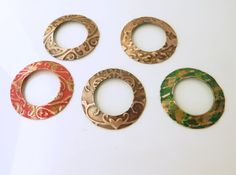 Please note:   These are each sold separately.   Price $10 each.  http://artisancomponentmarketplace.com/metapolies/store/products/one-embossed-copper-donut-component-hc14-060-through-064amc/