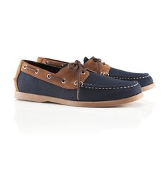 Canvas deck shoes with imitation leather and imitation suede details. Rubber soles.
