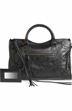Free shipping and returns on Balenciaga Classic Mini City Leather Tote at Nordstrom.com. Glossy, grained lambskin leather adds subtle shine to a beautifully structured tote punctuated with polished silvertone hardware.