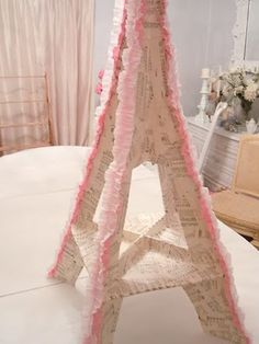 Eiffel Tower DIY for serving treats on....     Cute for Bridal Shower!