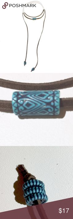 Brown and Turquoise Suede Wrap Choker -Chocolate brown suede   -Turquoise and black cylinder shaped center bead   -Three turquoise and black striped end beads Creative Adornments Jewelry Necklaces
