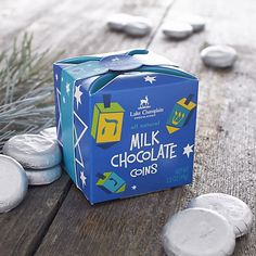 "Delectable milk chocolate ""coins"" from Lake Champlain Chocolates are individually wrapped in silver metallic foil and packed in a giftable Hanukkah box."