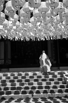 Buddhist monk entering into temple photographed by Abbas Attar